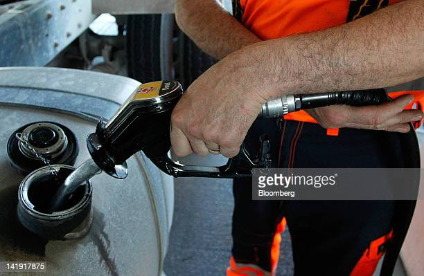 A truck driver fills his vehicle with Diesel fuel at a Morrison's gas station operated by William Morrison Supermarkets Plc in Manchester UK on...