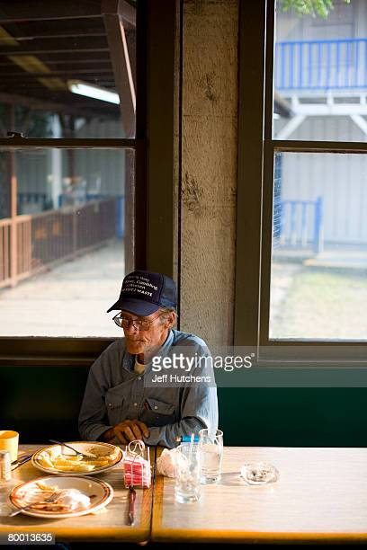 A truck driver grabs dinner and hangs out for the evening at the diner at South of the Border on July 21 2006 in Dillon South Carolina Nearly...
