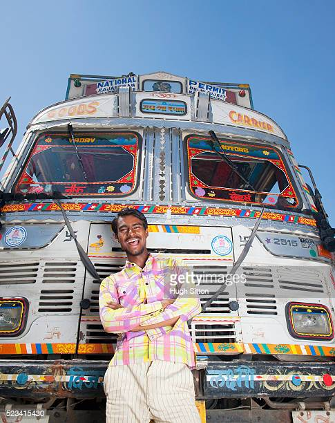 truck driver in front of colorful truck - hugh sitton india stock pictures, royalty-free photos & images