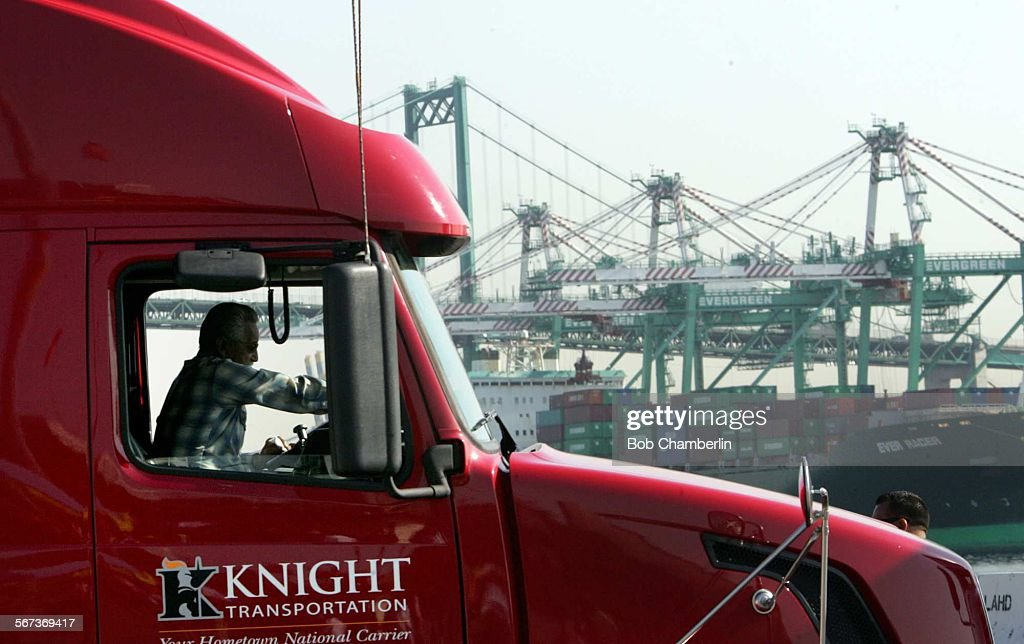 """SAN PEDRO, CA - OCTOBER 01, 2008: Truck driver Mel Garcia of Phoenix in the cab of his """"Knight Trans : News Photo"""
