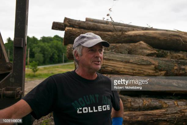 Truck driver Paul Fournier speaks about the hardwood logs he delivered to Robert Marble in Charlotte, Vermont, August 12, 2018. Firewood supplier...