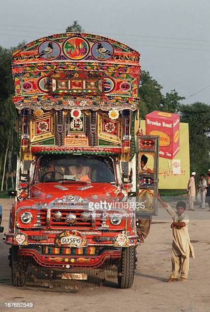 A truck driver takes a break on the climb up the hill that leads to the old hillstation town of Murree Trucks most of which are ornately decorated...