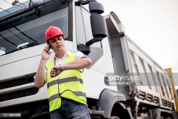 Truck driver talking on mobile phone
