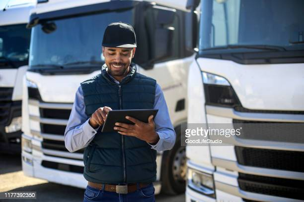 truck driver using a tablet - transportation stock pictures, royalty-free photos & images