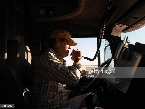 Truck Driver Using Two-Way Radio