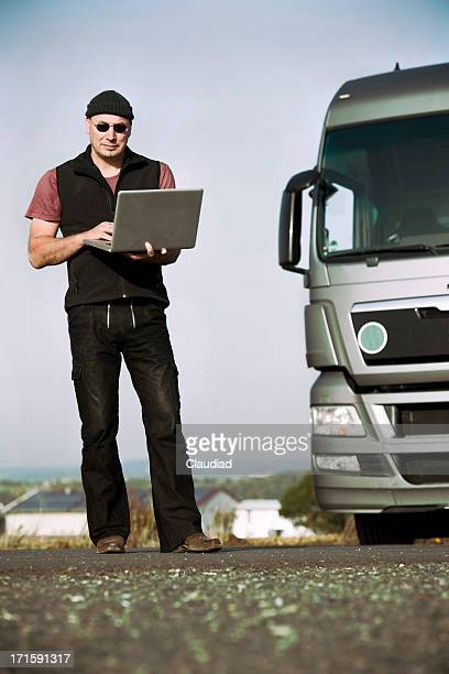 Truck driver with laptop