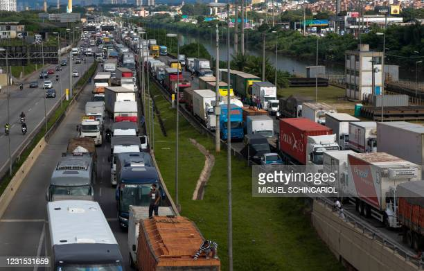 Truck drivers block the Castelo Branco tollway at the entrance of Sao Paulo, Brazil, as a protest against measures to close non-essential services in...
