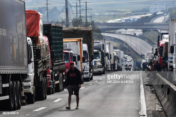 Truck drivers block the Regis Bittencourt road 30 km from Sao Paulo on May 26 2018 during a strike to protest rising fuel costs in Brazil that has...