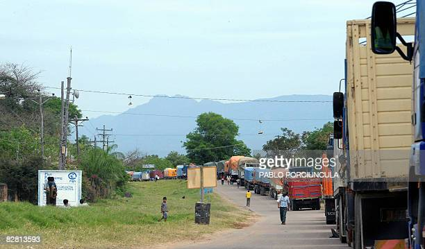 Truck drivers wait in line at a blocked route in Tiquipaya 46 km west of Santa Cruz on September 14 2008 The government of Bolivian President Evo...