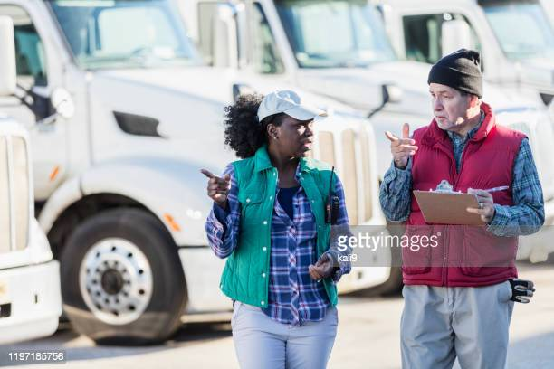 truck drivers with fleet of semi-trucks - trucker's hat stock pictures, royalty-free photos & images