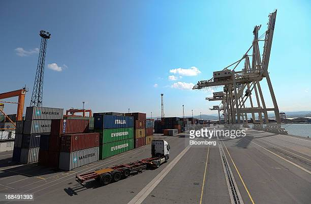 A truck drives along the dockside past AP MoellerMaersk A/S and Evergreen Marine Corp Taiwan Ltdbranded shipping containers at the port of Koper...