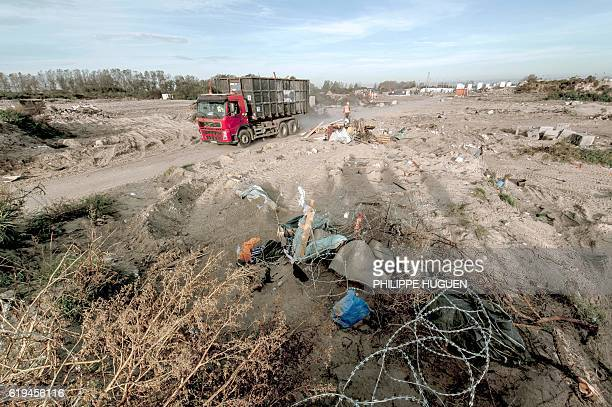 A truck drives at the site of the 'Jungle' migrant camp on October 31 2016 in Calais northern France as a massive operation to clear the settlement...