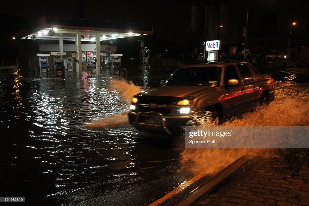 A truck drives by a flooded gas station in the Gowanus section of Brooklyn as Hurricane Sandy affects the area on October 29, 2012 in New York, United States. The storm, which threatens 50 million people in the eastern third of the U.S., is expected to bring days of rain, high winds and possibly heavy snow. New York Governor Andrew Cuomo announced the closure of all New York City will bus, subway and commuter rail service as of Sunday evening.