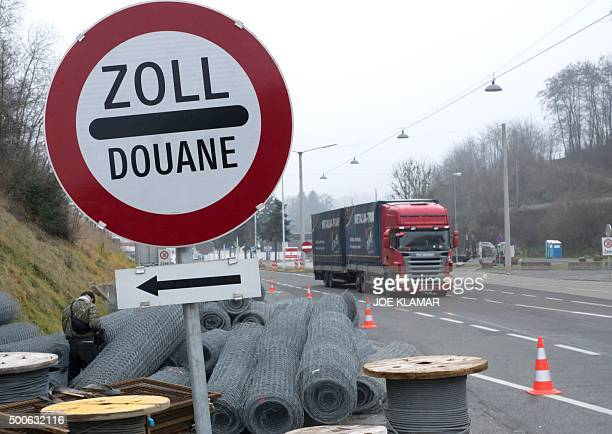A truck drives by rolls of a fence at Austrian and Slovenian border crossing in Spielfeld Austria on December 9 2015 Austria has begun to build a 37...