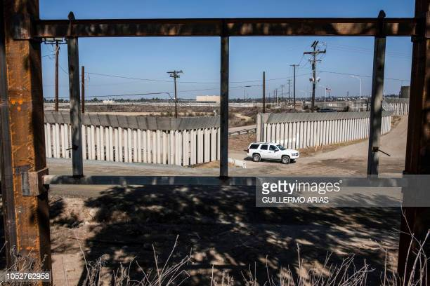 TOPSHOT A truck drives near a reinforced section of the USMexico border fence as seen from Tijuana Baja California state Mexico on October 22 2018 US...