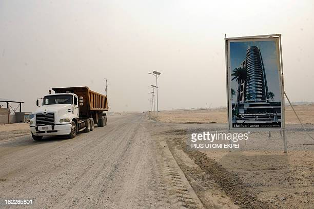 A truck drives past an advertising board for the Eko Pearl Tower a building of the future Eko Atlantic a new city born from the Altantic ocean in...