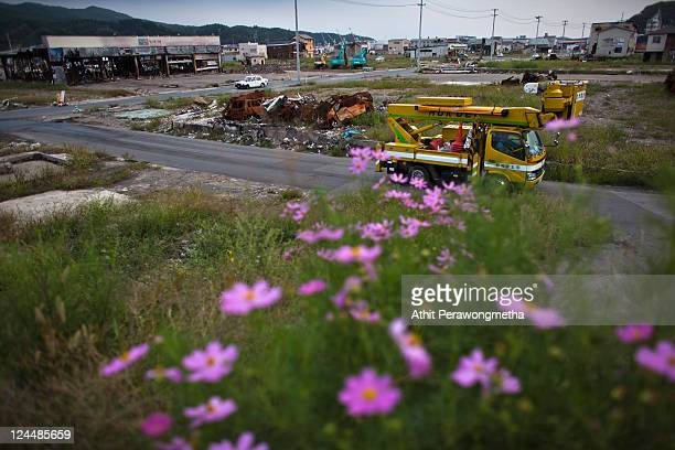 A truck drives past an devasted area prior to the sixth month anniversary of the March 11 earthquake and massive tsunami on September 10 2011 in...