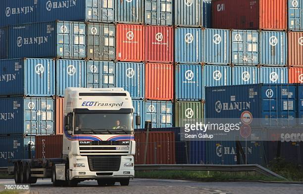 A truck drives past containers stacked at the main container port August 13 2007 in Hamburg Germany Northern Germany with its busy ports of Hamburg...