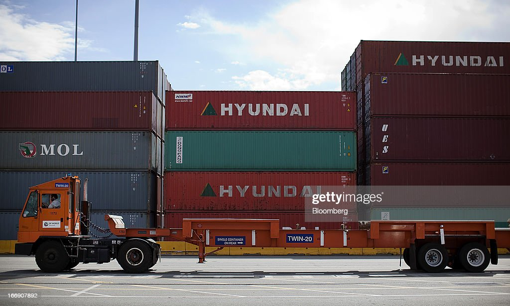 A truck drives past freight containers stacked up after being unloaded from a ship at the Port Metro Vancouver terminal in Vancouver, British Columbia, Canada, on Tuesday, April 16, 2013. Port Metro Vancouver, Canada's largest and busiest port, is the principal authority for shipping and port-related land and sea use in the Metro Vancouver region. Photographer: Ben Nelms/Bloomberg via Getty Images