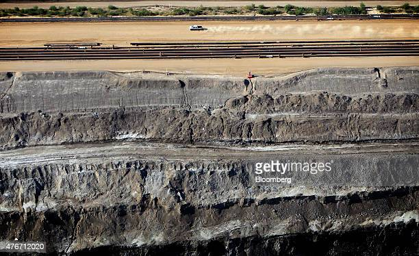 A truck drives past the Syncrude Canada Ltd oil sands mine in this aerial photograph taken near Fort McMurray Alberta Canada on Thursday June 4 2015...