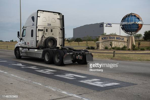 A truck drives past the World Trade International Bridge in