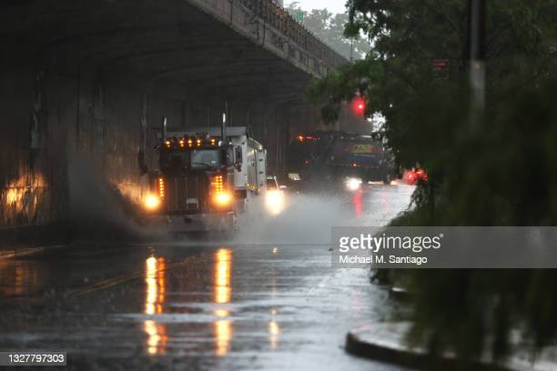 Truck drives through slight flooding on Furman Street in the Brooklyn Heights neighborhood of Brooklyn on July 09, 2021 in New York City. NYC is...