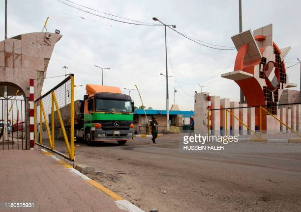 A truck drives through the gate of the southern Iraqi port of Umm Qasr after it reopened on November 7 2019 A sitin had cut the road to the Umm Qasr...