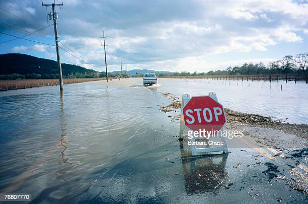 Truck driving down flooded road