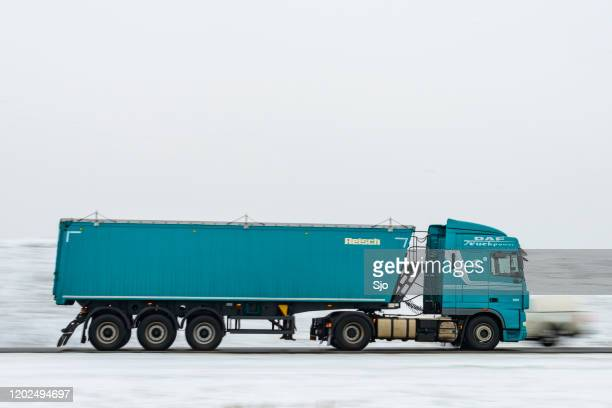 """truck driving in winter conditions hauling a trailer. panning image with motion blur - """"sjoerd van der wal"""" or """"sjo"""" nature stock pictures, royalty-free photos & images"""