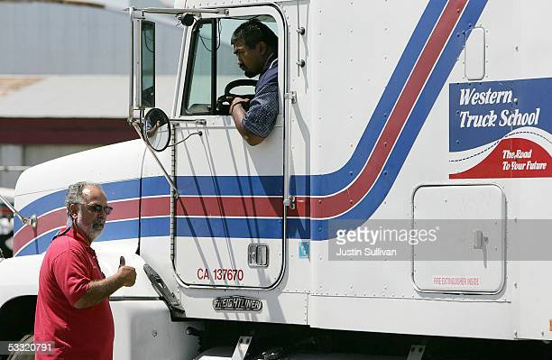 Truck driving instructor Dan Martin directs student Ron Prasad as he manuevers a truck while training at the Western Trucking School August 3 2005 in...