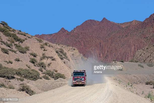 Truck driving on dirt road Route 21 / Ruta 21 on the high plateau of the Altiplano, between Tupiza and Uyuni, Potosí Department, Bolivia.