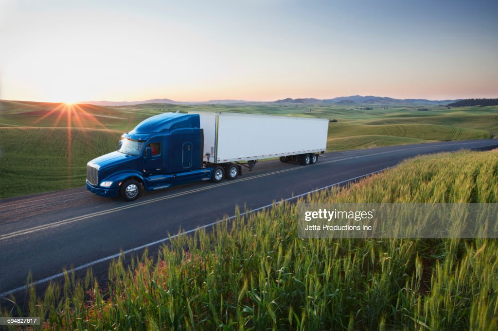 Truck driving on remote highway : Stock Photo