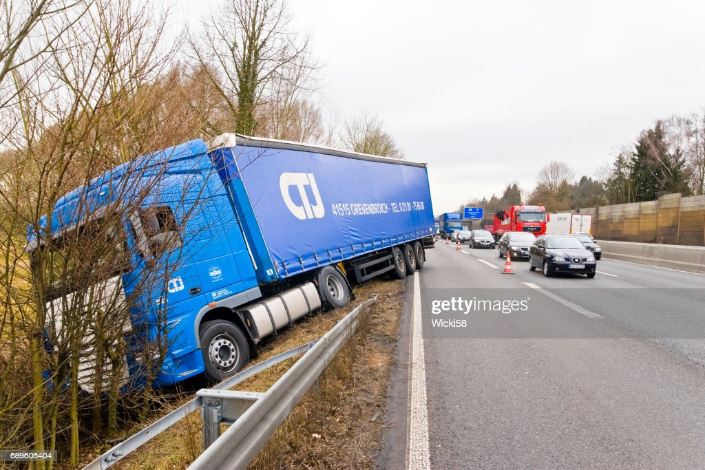 Truck driving on the highway into the embankment : Stock Photo