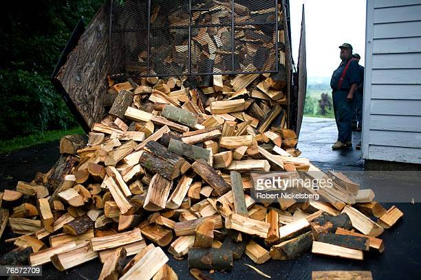 A truck drops a cord of firewood at a residence on July 9 2007 in Charlotte Vermont With the high price of heating oil many homes have switched over...