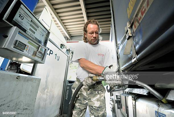 Truck drvier refuels his vehicle at a gas station in Kufstein, Austria, on Monday, May 18, 2009. Demand for distillate fuel, which includes diesel...