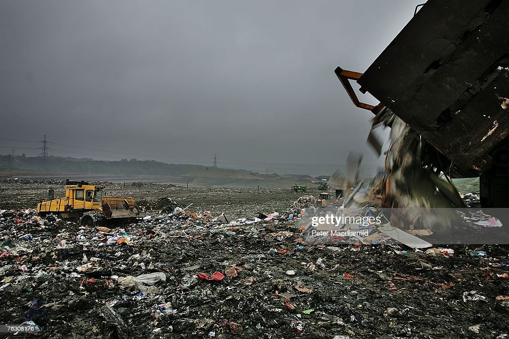 A truck empties its load of waste at the Shelford Landfill, Recycling & Composting Centre on August 23, 2007 near Canterbury, England. The Shelford landfill site, run by Viridor Waste Management, receives 200 truck loads of waste weighing 2100 metric tonnes a day.