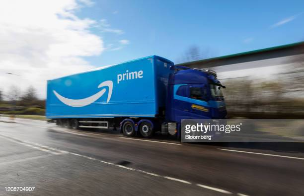 A truck featuring Amazon Prime livery heads towards an Amazoncom Inc customer fulfillment center in Milton Keynes UK on Monday March 30 2020 UK...