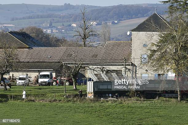 A truck for the carcasses of animals arrives as members of the French National Health and Safety Agency work on a duck farm in the municipality of...
