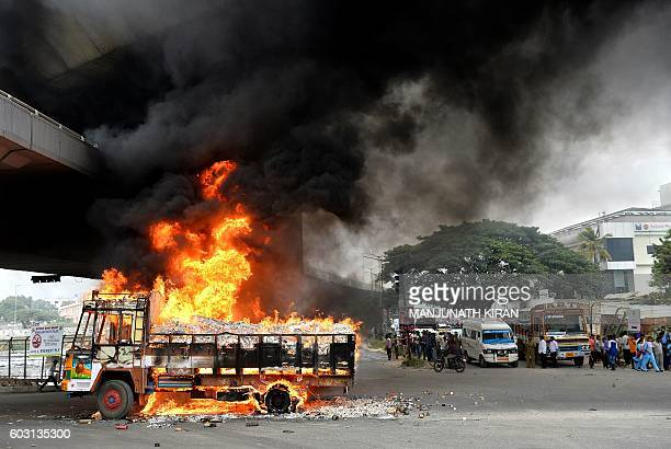 A truck from neighbouring state Tamil Nadu burns after it was set alight by agitated proKarnataka activists as the Cauvery water dispute erupted...