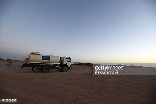 A truck from the European Humanitarian Aid and Civil Protection drives on March 3 at the Sahrawi refugee camp of Boujdour near the Algerian city of...