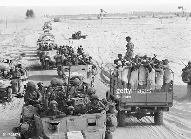 A truck full of captured Egyptian soldiers meets a convoy of Israeli troops near El Arish Egypt The Israelis had taken El Arish and are heading...
