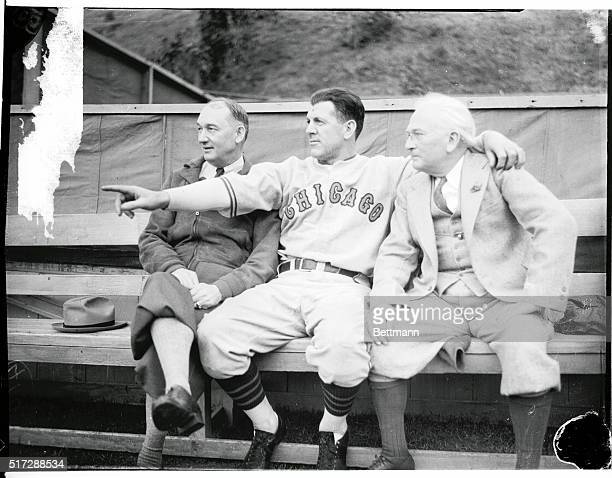 Truck Hannah ex Angel catcher now Coach Art Veltman Catcher and Manager Jack Lelivelt are shown as the Angels start ball practice for pitchers and...