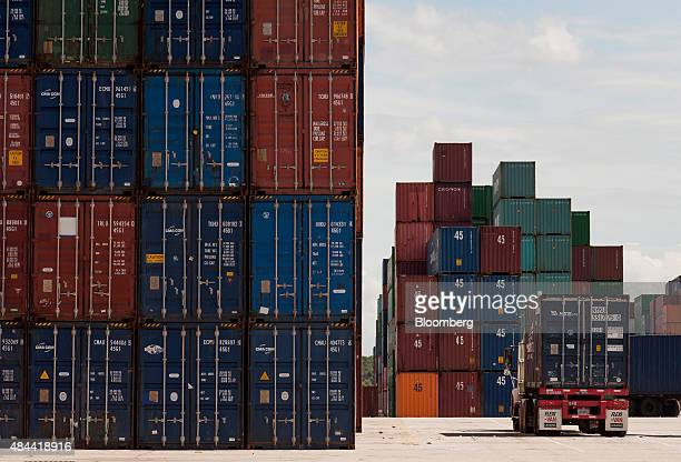 A truck hauling a shipping container sits at the Port of Savannah in Savannah Georgia US on Friday Aug 14 2015 The trade deficit in the US widened in...