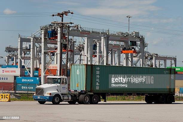 A truck hauls a China Shipping Container Lines Co container at the Port of Savannah in Savannah Georgia US on Friday Aug 14 2015 The trade deficit in...