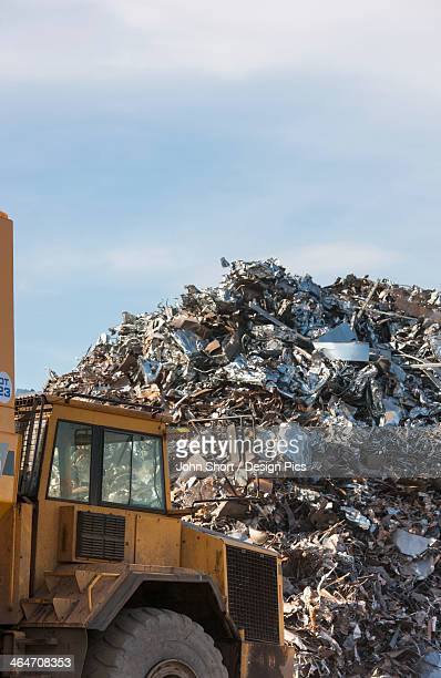 a truck in front of a large pile of garbage - landfill stock photos and pictures