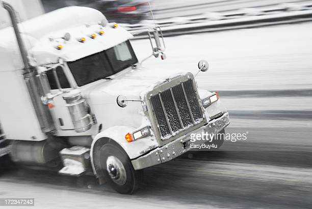 Truck in motion during a snow storm
