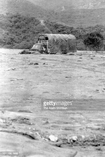 Truck is buried in lahars triggered by the eruption of the Mt. Nevado del Ruiz on November 17, 1985 in Armero, Colombia.