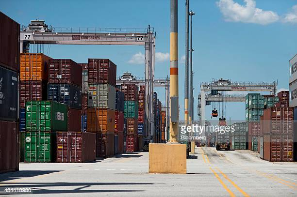 Truck is loaded with a shipping container at the Port of Savannah in Savannah, Georgia, U.S., on Friday, Aug. 14, 2015. The trade deficit in the U.S....