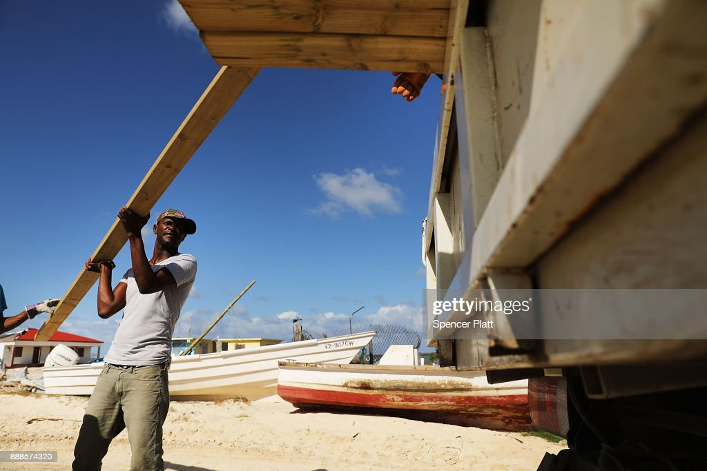 A truck is loaded with plywood on the nearly destroyed island of Barbuda on December 8, 2017 in Cordington, Barbuda. Barbuda, which covers only 62 square miles, was nearly leveled when Hurricane Irma made landfall with 185mph winds on the night of September six. Only two days later, fearing Barbuda would be hit again by Hurricane Jose, the prime minister ordered an evacuation of all 1,800 residents of the island. Most are now still in shelters scattered around Barbuda's much larger sister island Antigua.