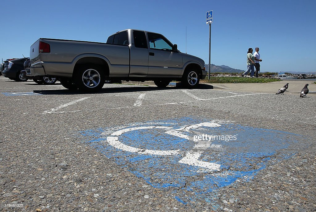 A truck is parked in a disabled parking spot on July 20, 2011 in San Francisco, California. The California DMV says that is has sent out nearly 60,000 disabled parking placards to dead people since the DMV only checks state death records every two years. The disabled parking placards allow handicapped motorists to park for free and in designated parking spots.
